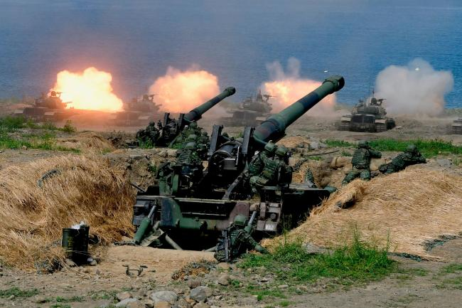 © Bloomberg. US-made CM-11 tanks (in background) are fired in front of two 8-inch self-propelled artillery guns during the 35th