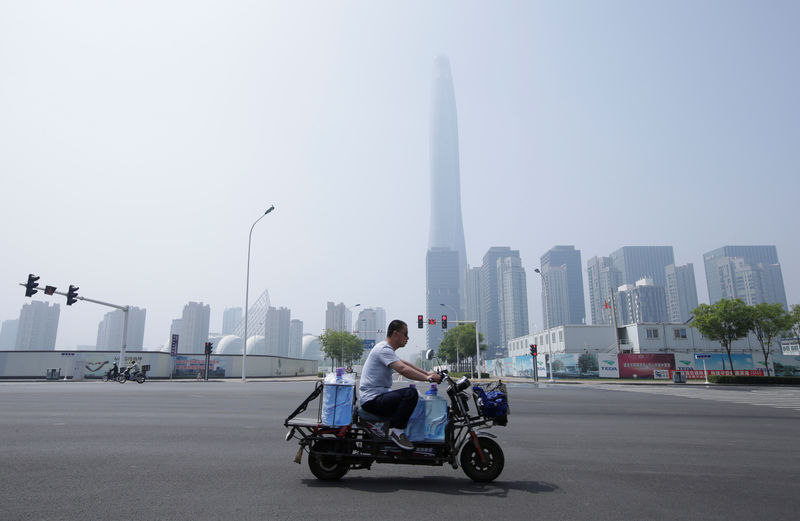 Chinese growth to slow over time: PBOC By Reuters