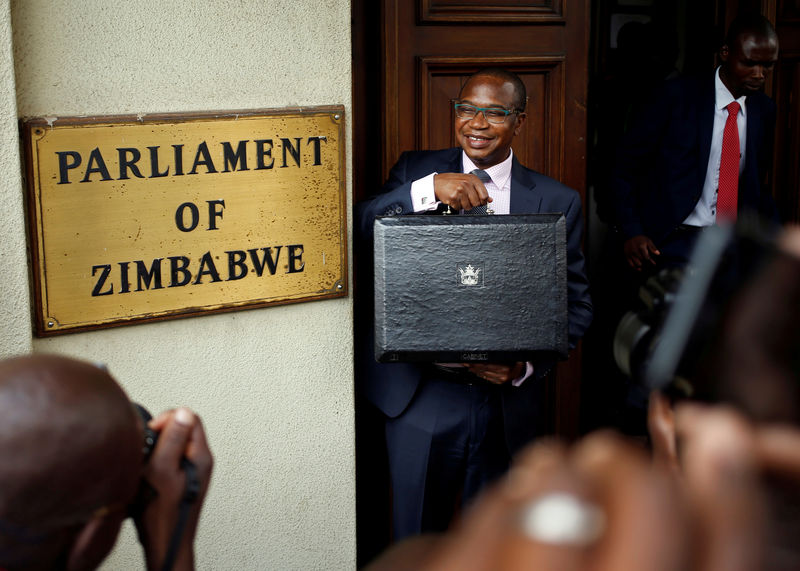 © Reuters. FILE PHOTO: Zimbabwean Finance Minister Mthuli Ncube arrives to deliver his 2019 Budget speech at Parliament in Harare