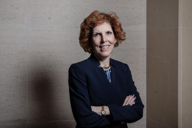"""© Bloomberg. Loretta Mester, president of the Federal Reserve Bank of Cleveland, poses for a photograph following a Bloomberg Television interview at the French central bank and Global Interdependance Center (GIC) conference in Paris, France, on Monday, May 14, 2018. European Central Bank policy maker Francois Villeroy de Galhau said the first interest-rate increase could come """"some quarters, but not years"""" after policy makers end their bond-buying program."""