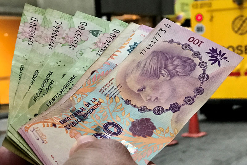 Argentine peso gets knocked lower, country risk soars as government eyes debt 'reprofiling' By Reuters