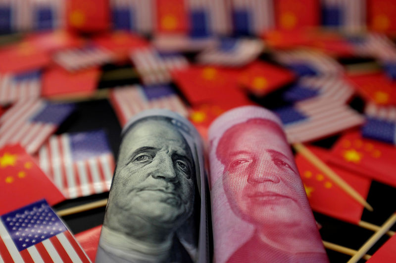 © Reuters. FILE PHOTO: Illustration picture showing U.S. dollar and China