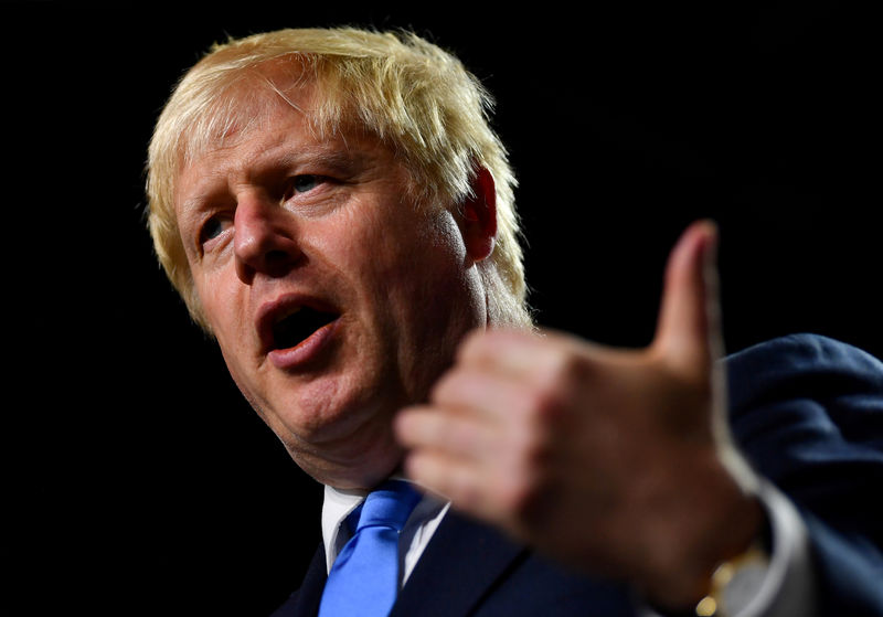 UK's Johnson says he will continue to bring down public debt By Reuters