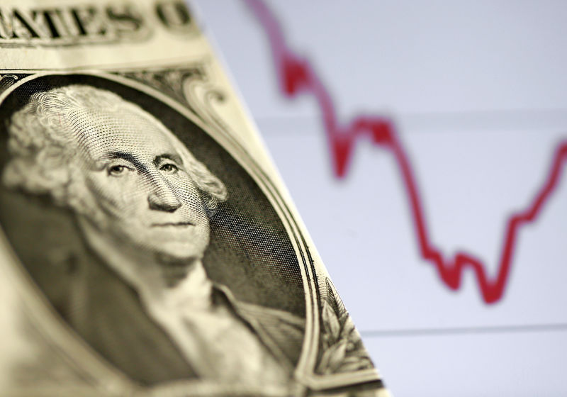 © Reuters. A U.S. dollar note is seen in front of a stock graph in this picture illustration
